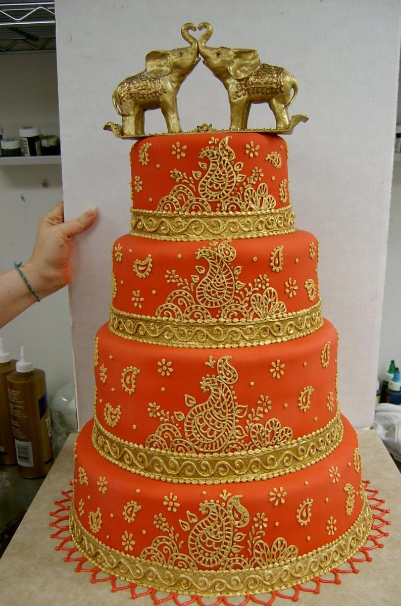 Gorgeous Indian Wedding Cake In Gold and Orange with an Elephant Topper