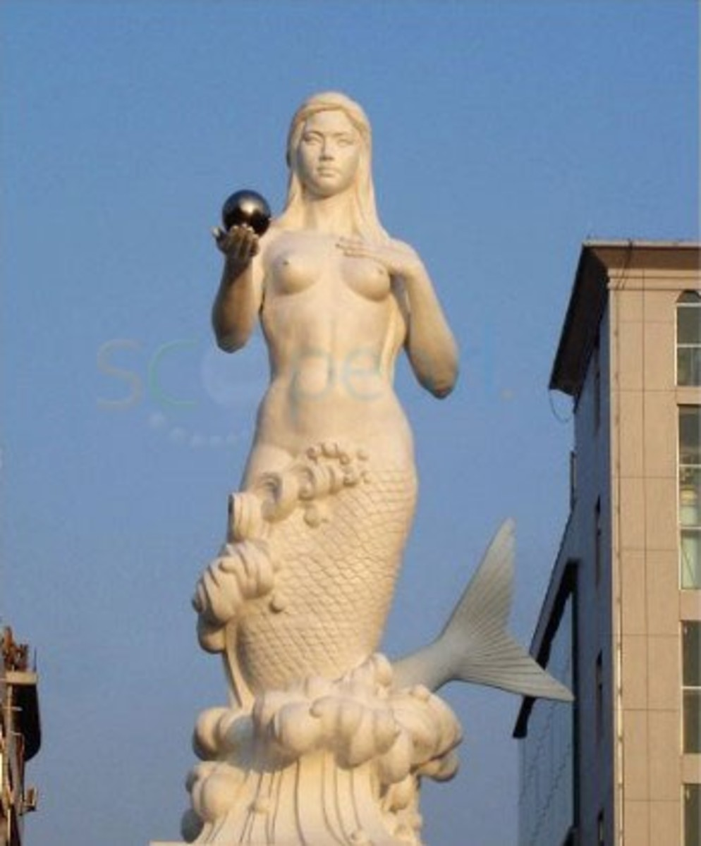 Statue of a Chinese Mermaid, known as a Pearl Queen. Note, the pearl she is holding in her hand.