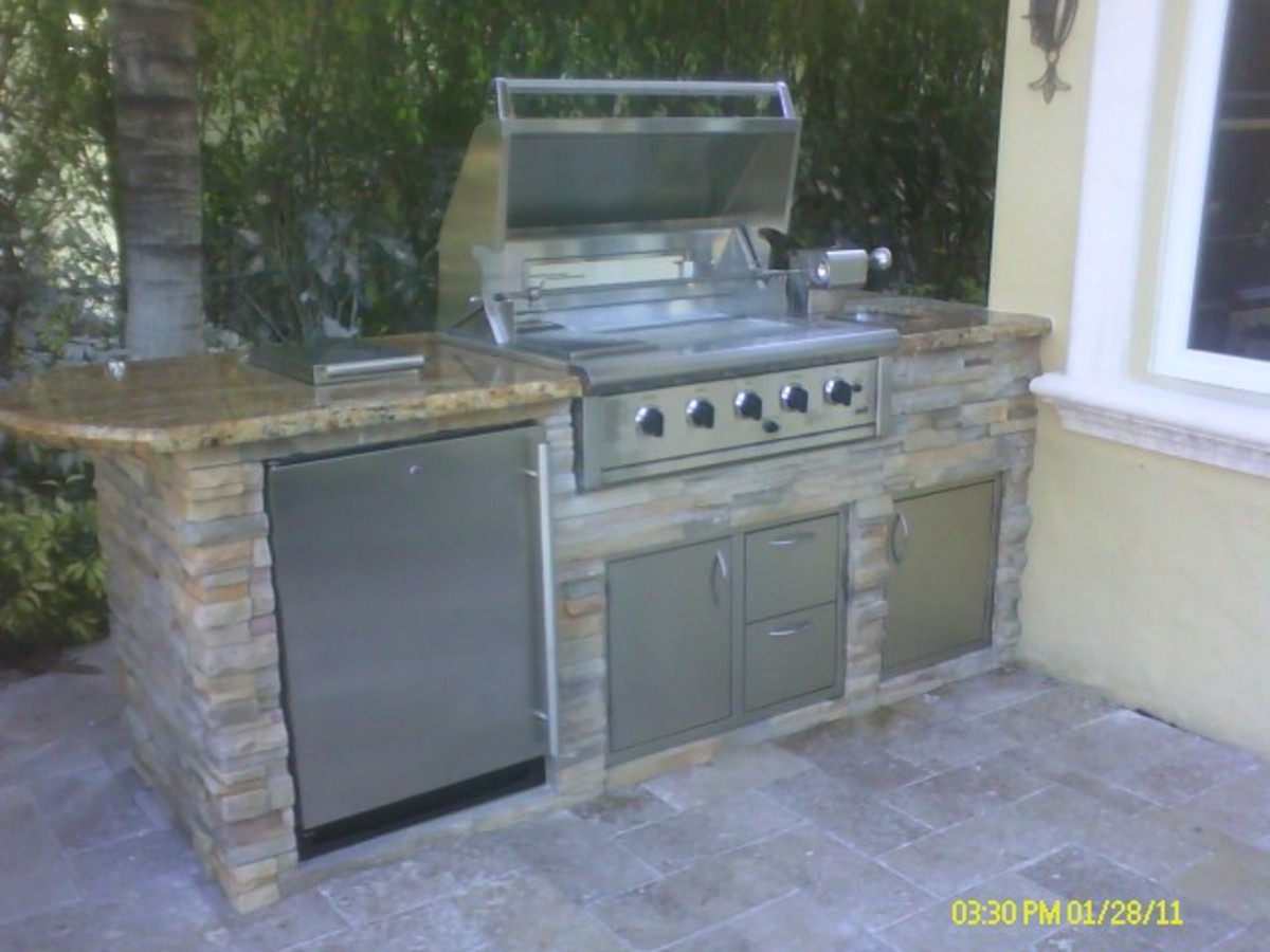 "Custom kitchen with OCI built in 36"" bbq grill.  Hybrid design of infrared and convection burners, rotisserie burner, halogen lights, smoker tray and burner"
