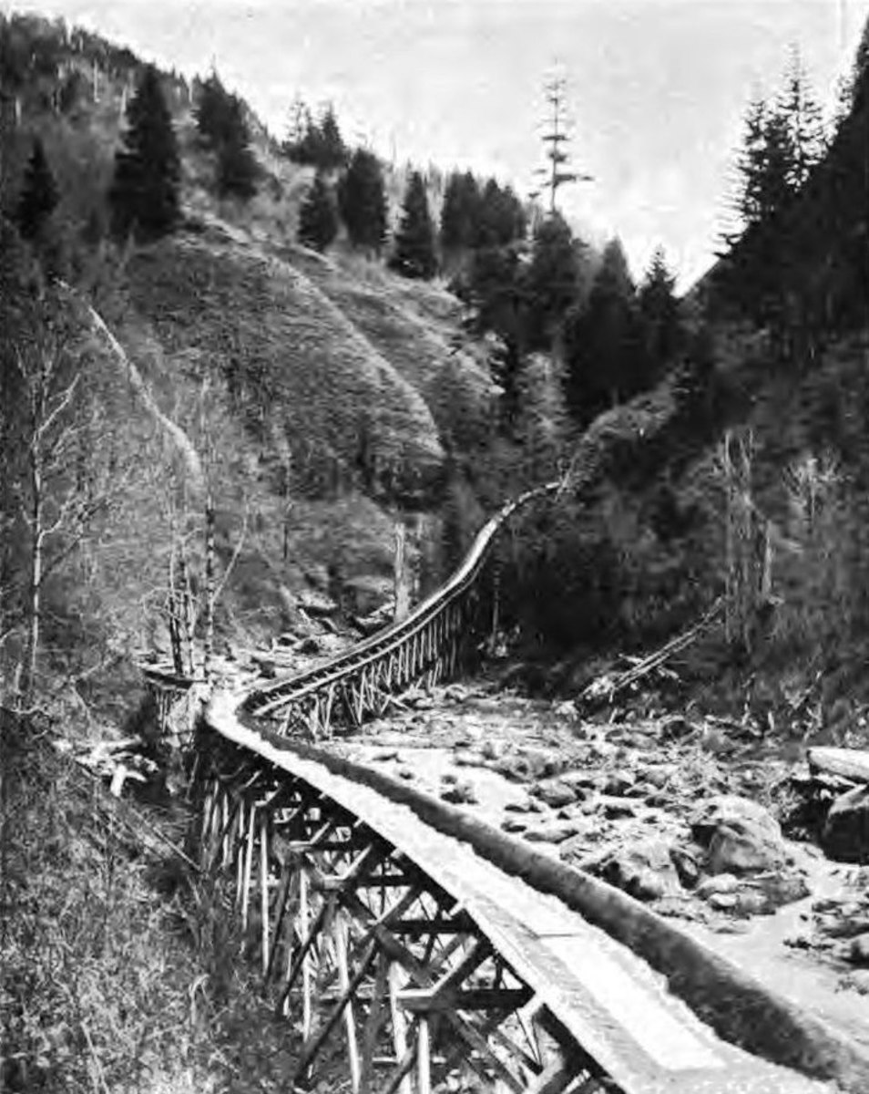 Old photo of a lumber flume