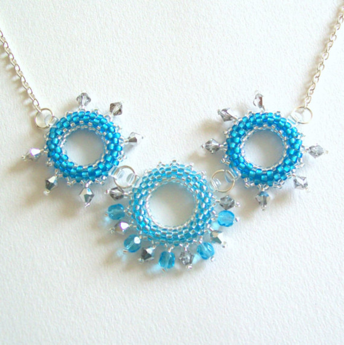 Use wire components to linked beaded rings for bracelets or necklaces.