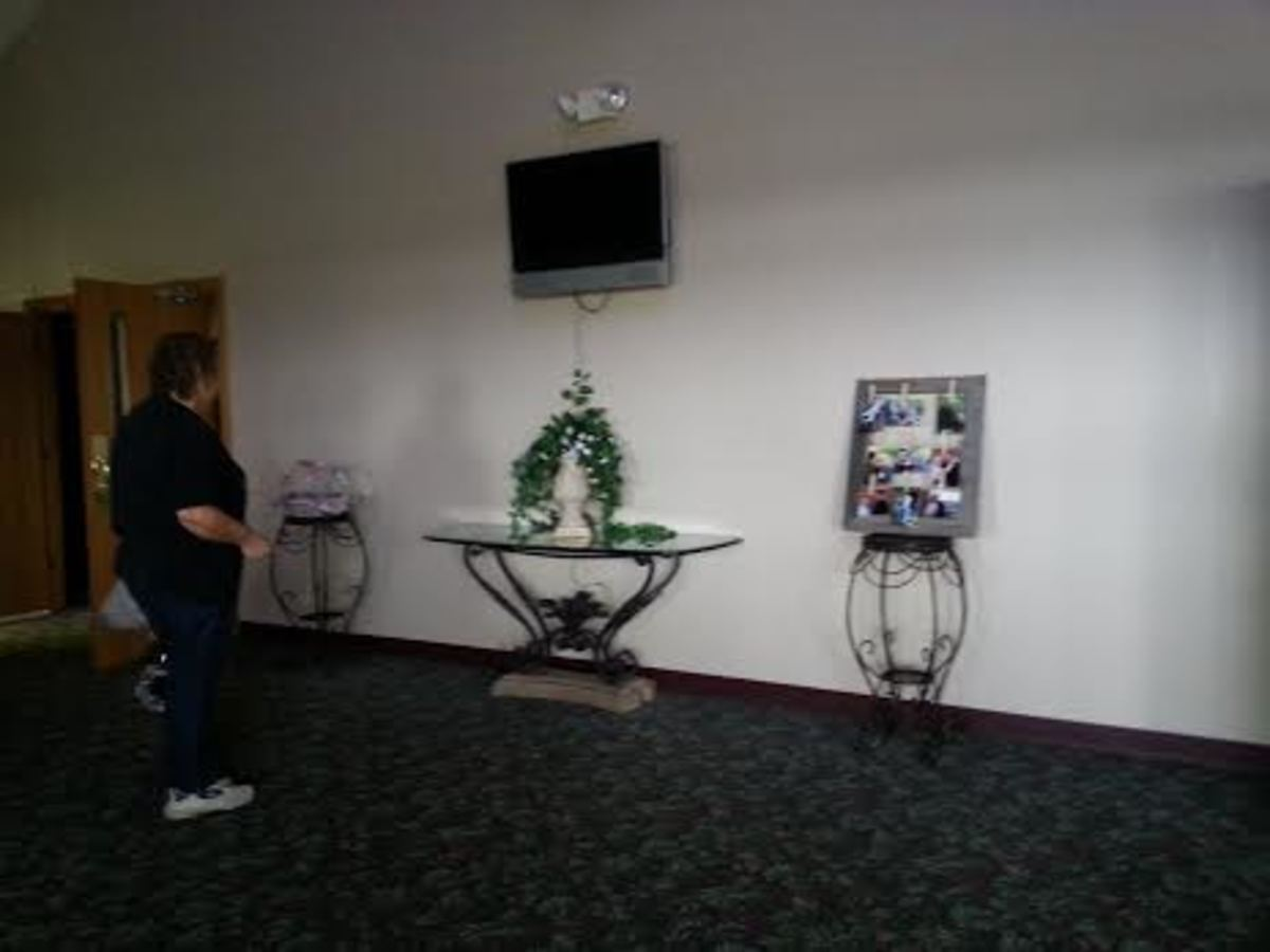 Many church foyers have screens in the foyer where you can view the service while quieting a chatty or crying child.