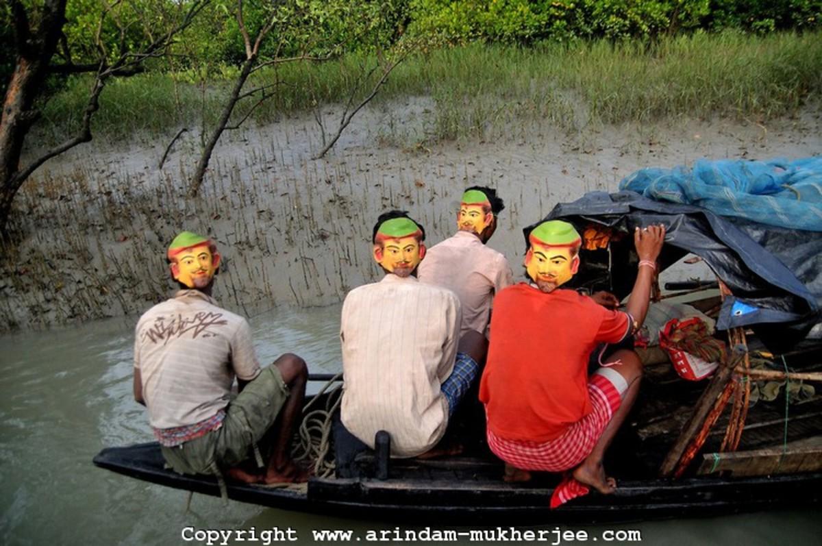 Local fishermen with backwards masks