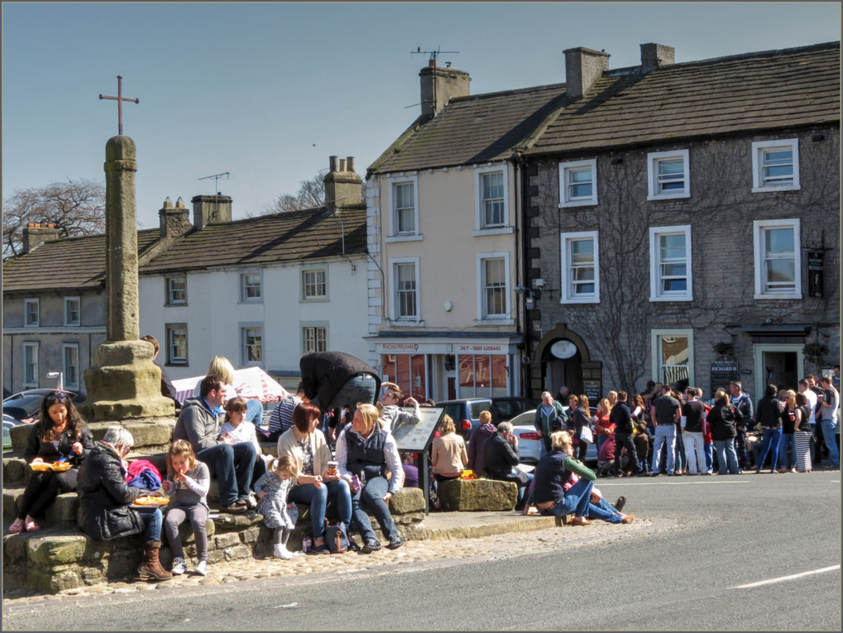 The Market square, and visitors flock in the sunshine - there are several hotels, pubs and coffee shops to keep them happy should the weather turn, which is always on the cards!