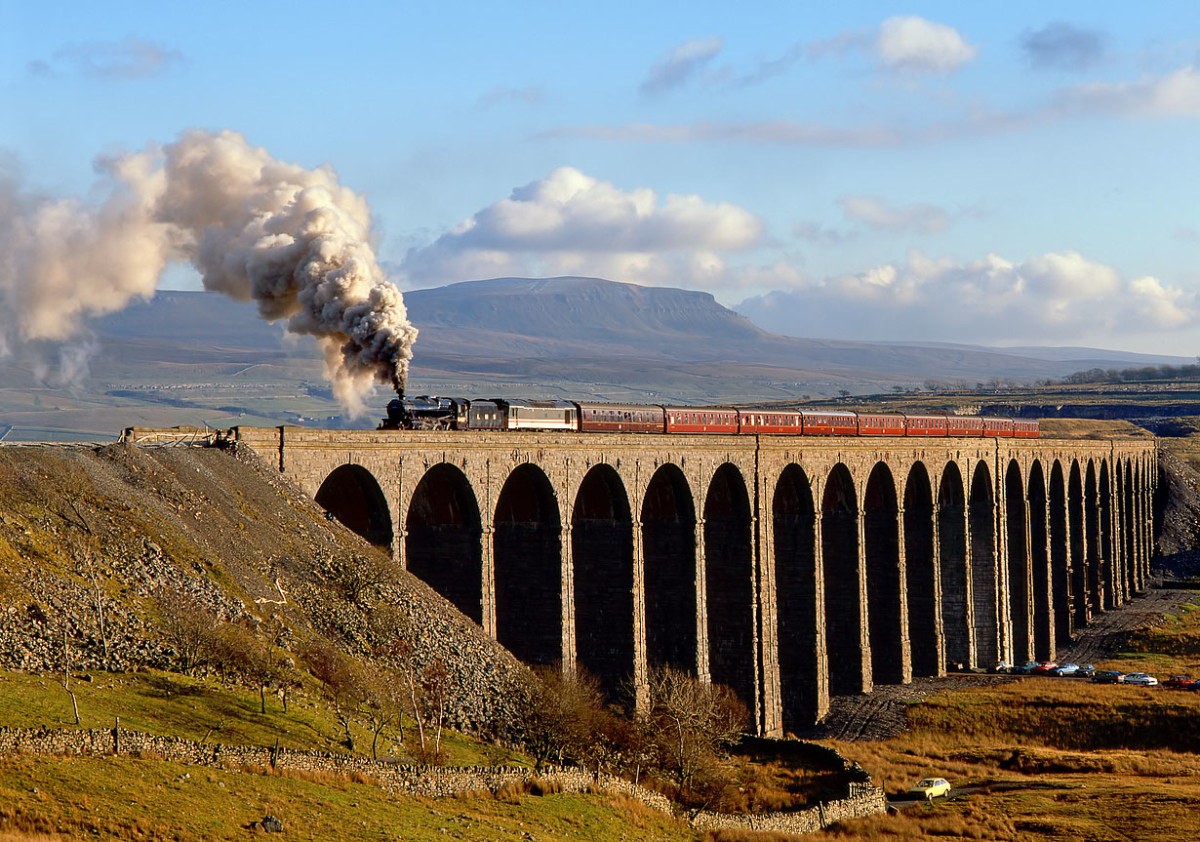 Ribblehead Viaduct looking south-east on a bright day with a preserved Black Five in LMS livery hauling a Cumbrian mountain steam special