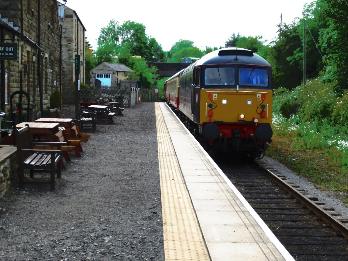Leyburn Station, Wensleydale Railway Heritage Diesel 'Poseidon' draws to a halt with WR stock heading east. The WR has almost completed its passing loop here; trains to Redmire can pass those to Leeming Bar - more trains on the line!