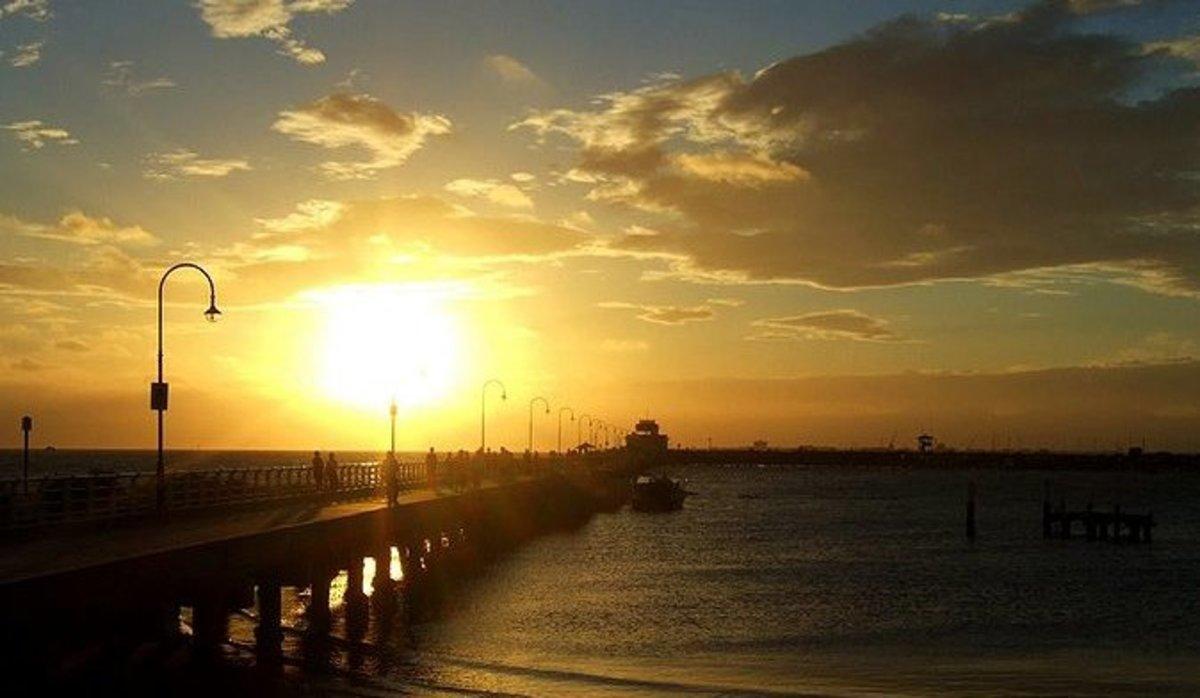Enjoy serene views of the sunset at the St Kilda Pier