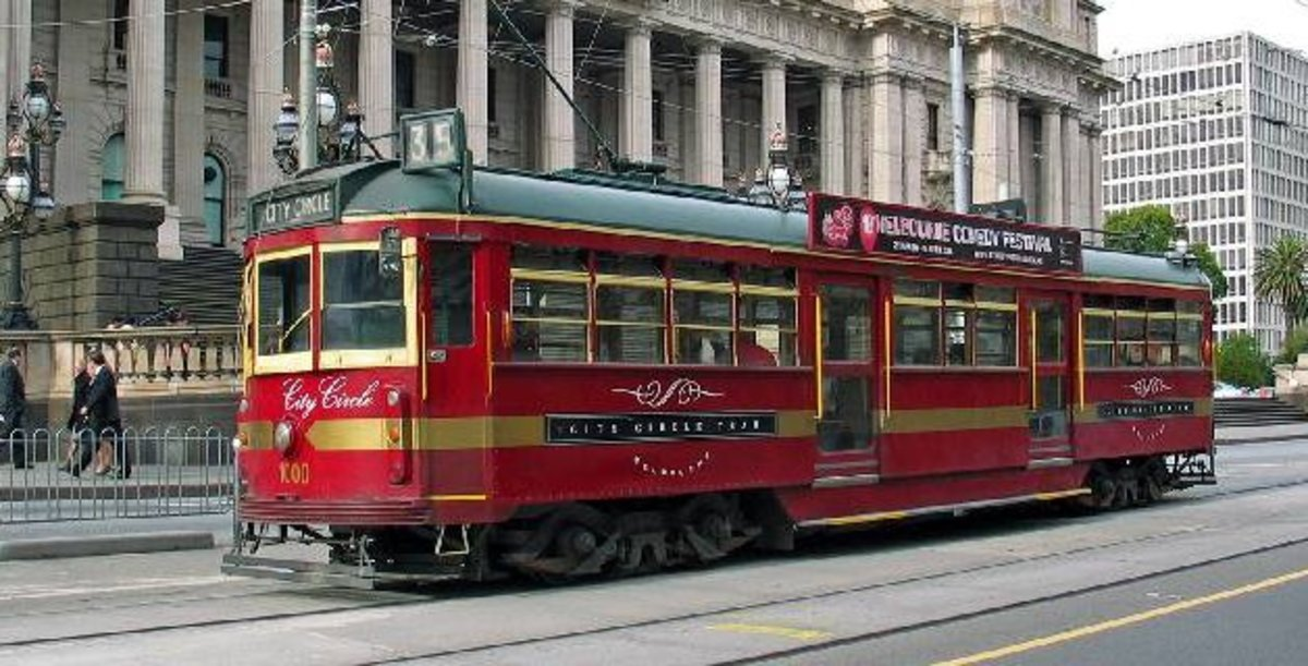 The City Circle Tram passing by the Parliament of Victoria, on Spring Street, Melbourne