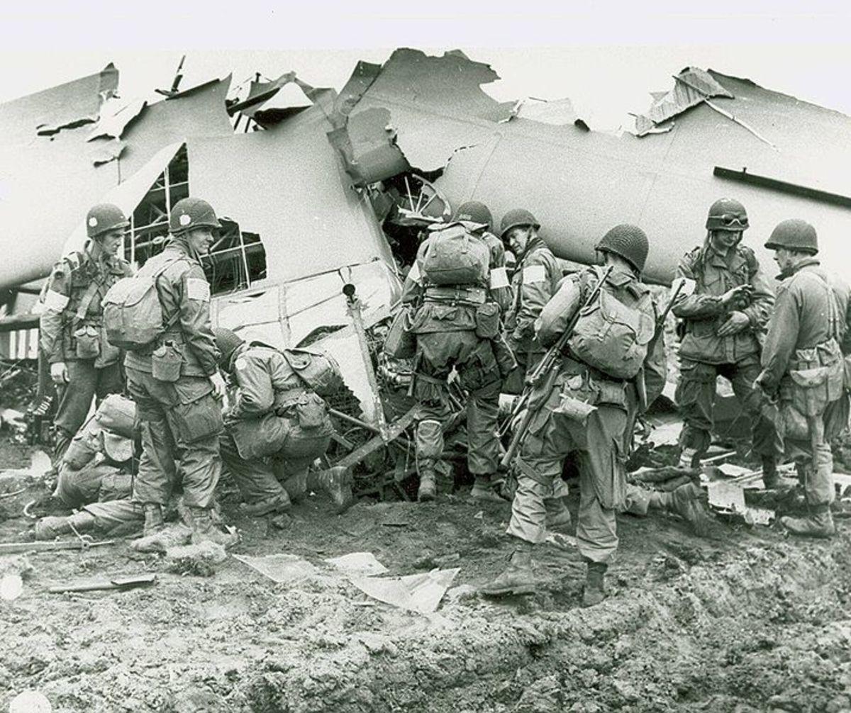 U.S. Paratroopers examining a downed aircraft