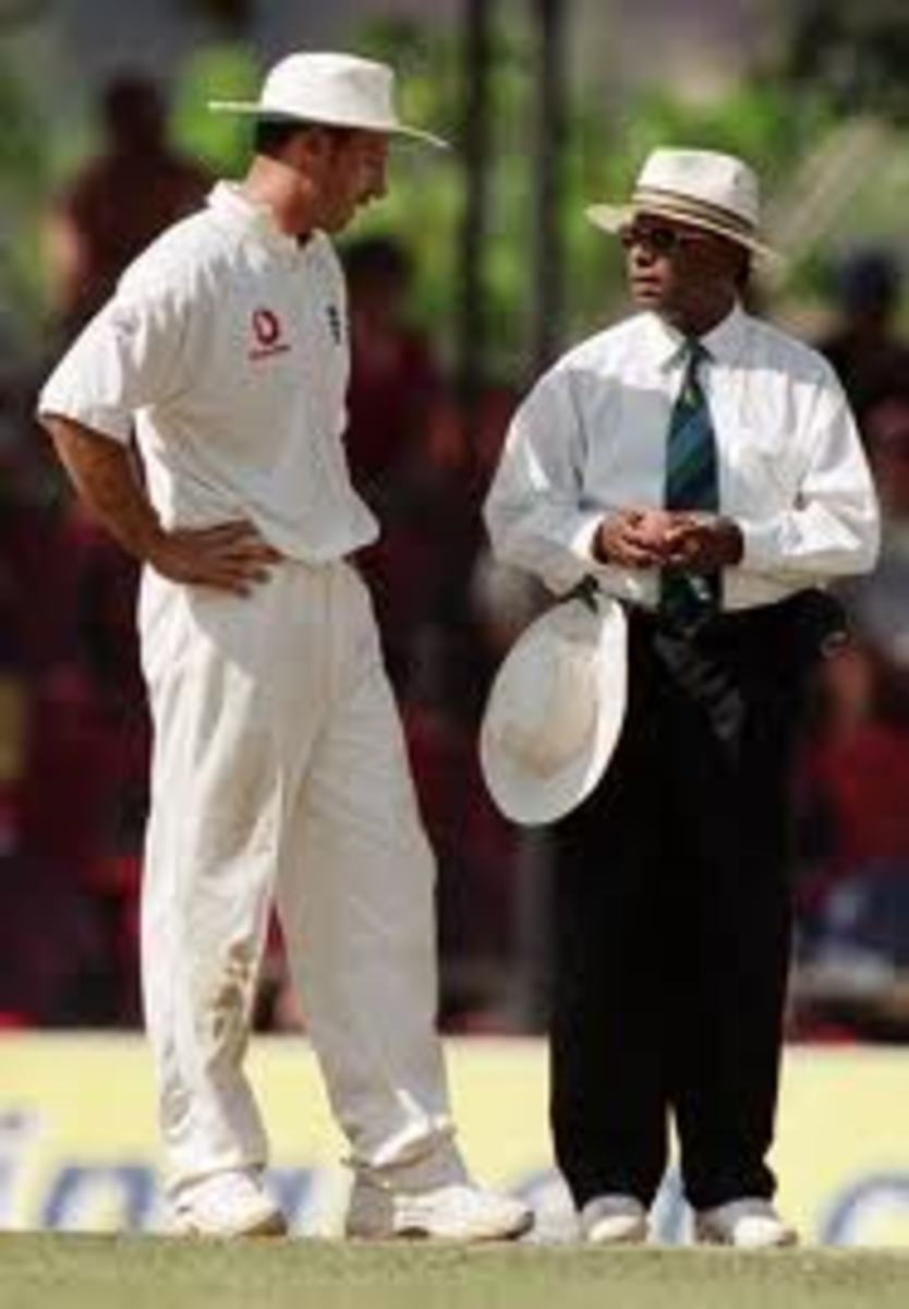 Former England captain Nasser Hussain is probably asking Bad Call Cooray about a recent decision.