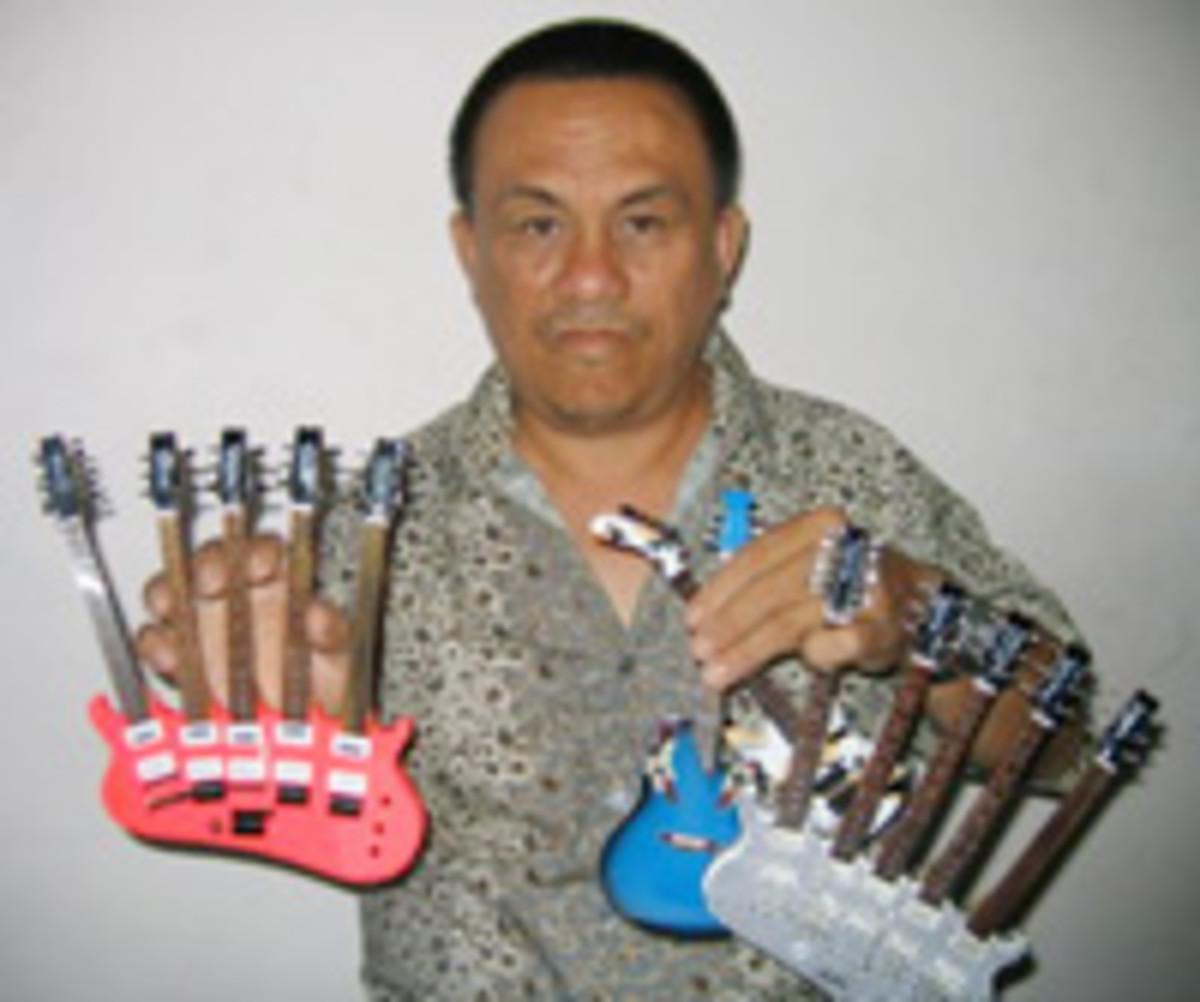 Kadir Ngamino with his mini guitar