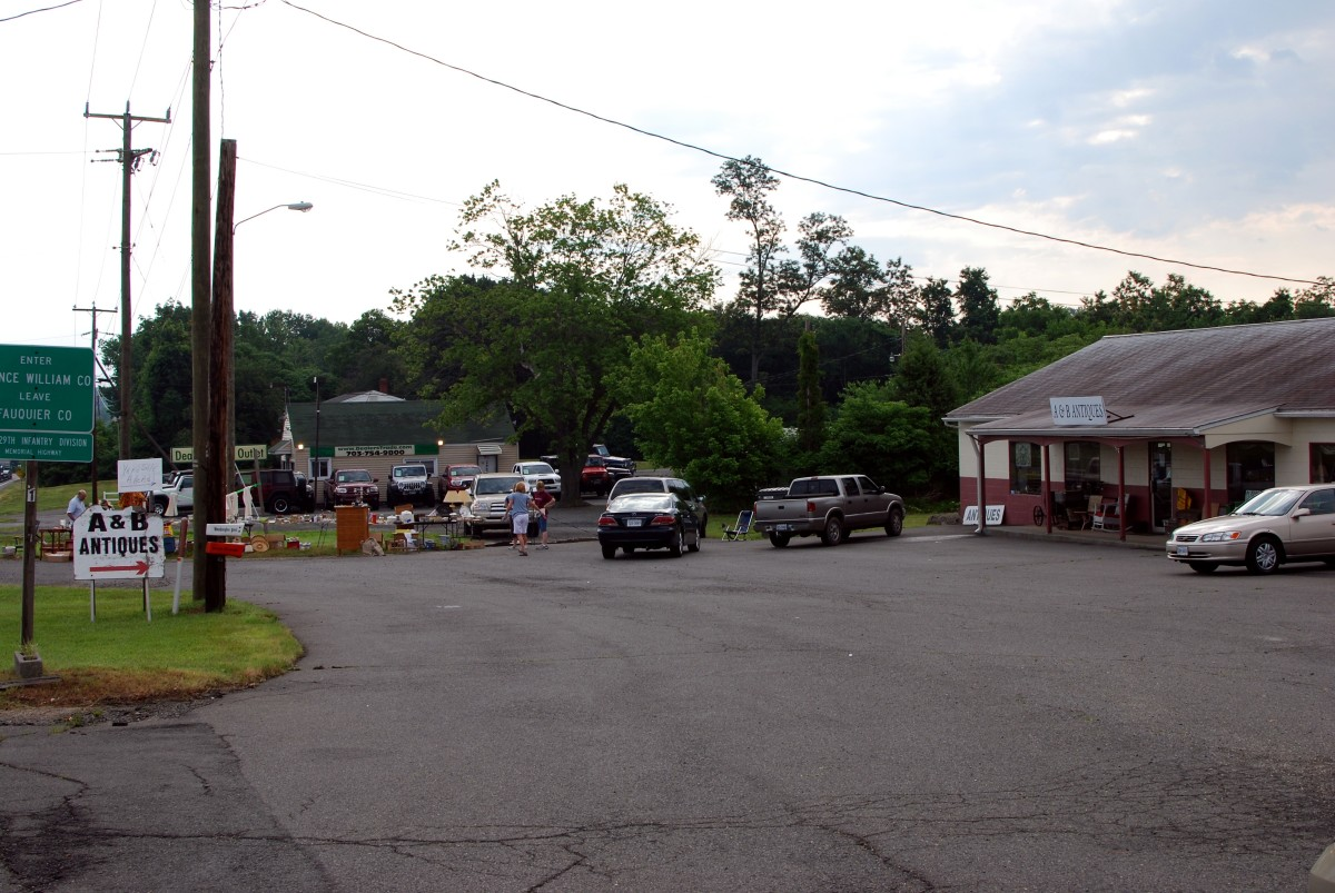 Interesting, yard sale in an antique shop parking lot. Get 2 for 1 stop.