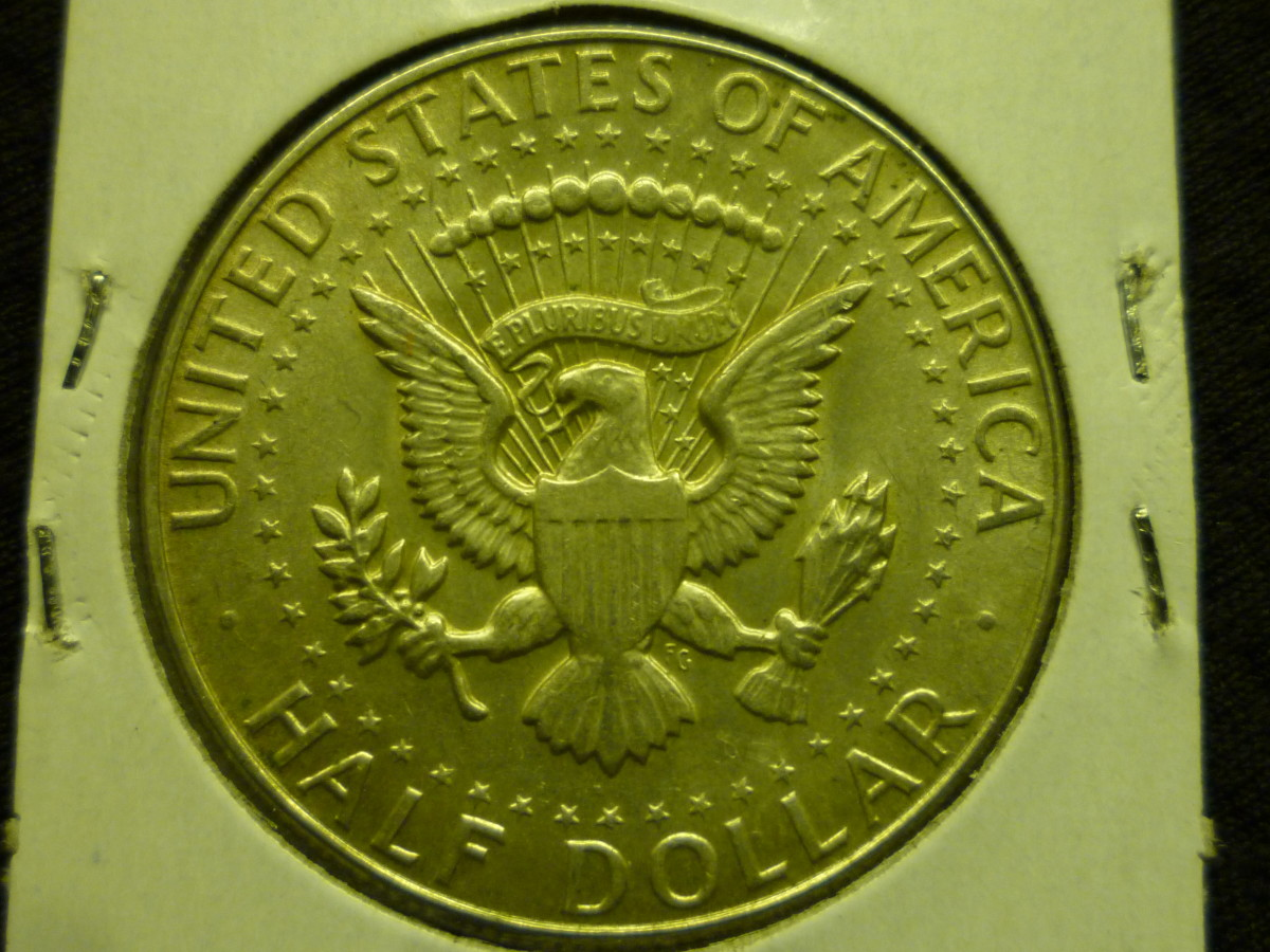 Above: Regular Kennedy Reverse.  Below: Bicentennial Kennedy Reverse.