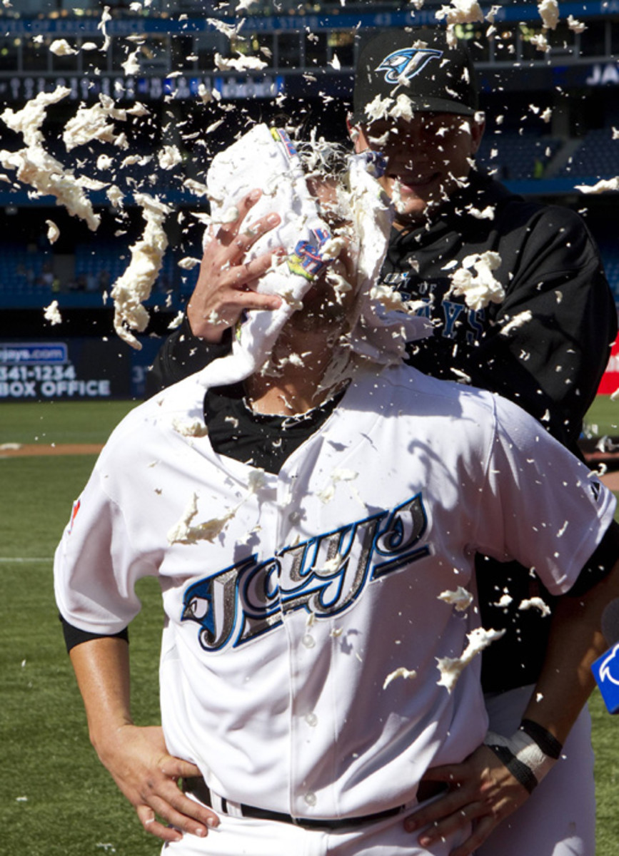 On August 7, 2010, Toronto Blue Jays J.P. Arencibia gets a celebratory shaving cream pie in the face after opening night Blue Jays win.  It was Arencibia's first major league appearance.