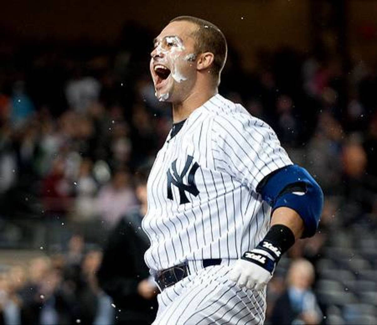 On April 14, 2011, Yankees Nick Swisher delivered the game-winner with a sacrifice fly in the 10th, stunning the Orioles with a dramatic 6-5 win.  He got a celebratory pie in the face.