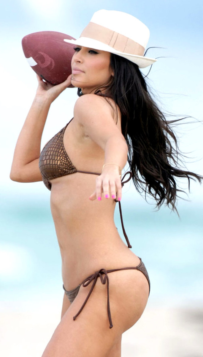 Kim Kardashian in bikini. Notice how she's been wearing a lot of bikini bottoms with straps.