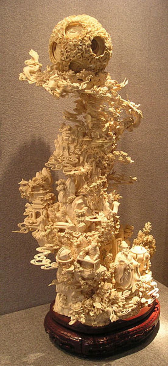 1900s Chinese ivory sculpture. The globe at the top has 54 independently rotating layers. Photo taken by Bmdavll in Jan. 2007 in Guangzhou, China.).jpg