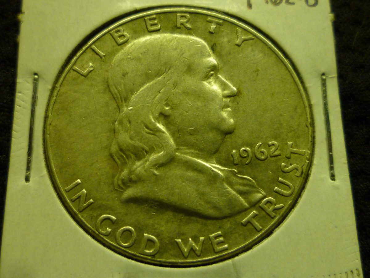 Circulated 1962 Franklin Half Dollar. This coin as with most circulated Franklin Half Dollars is worth the melt value of $14.60