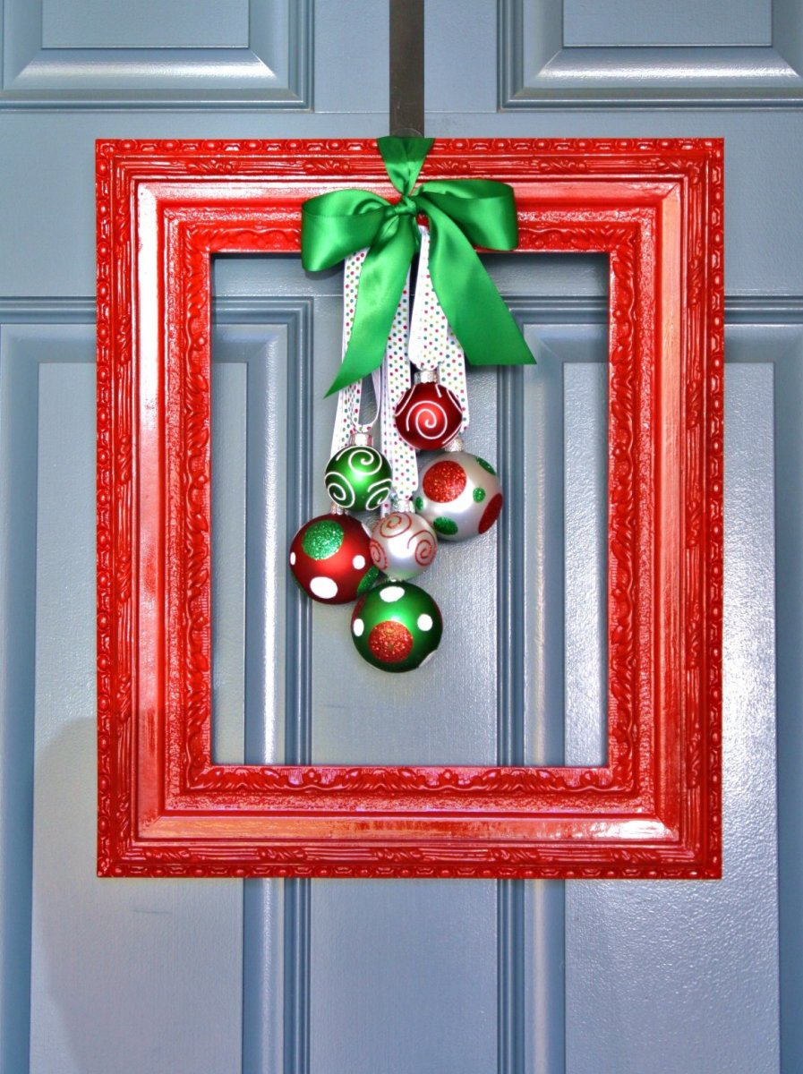 A simple picture frame and a couple of ornaments make a fun alternative to a wreath.