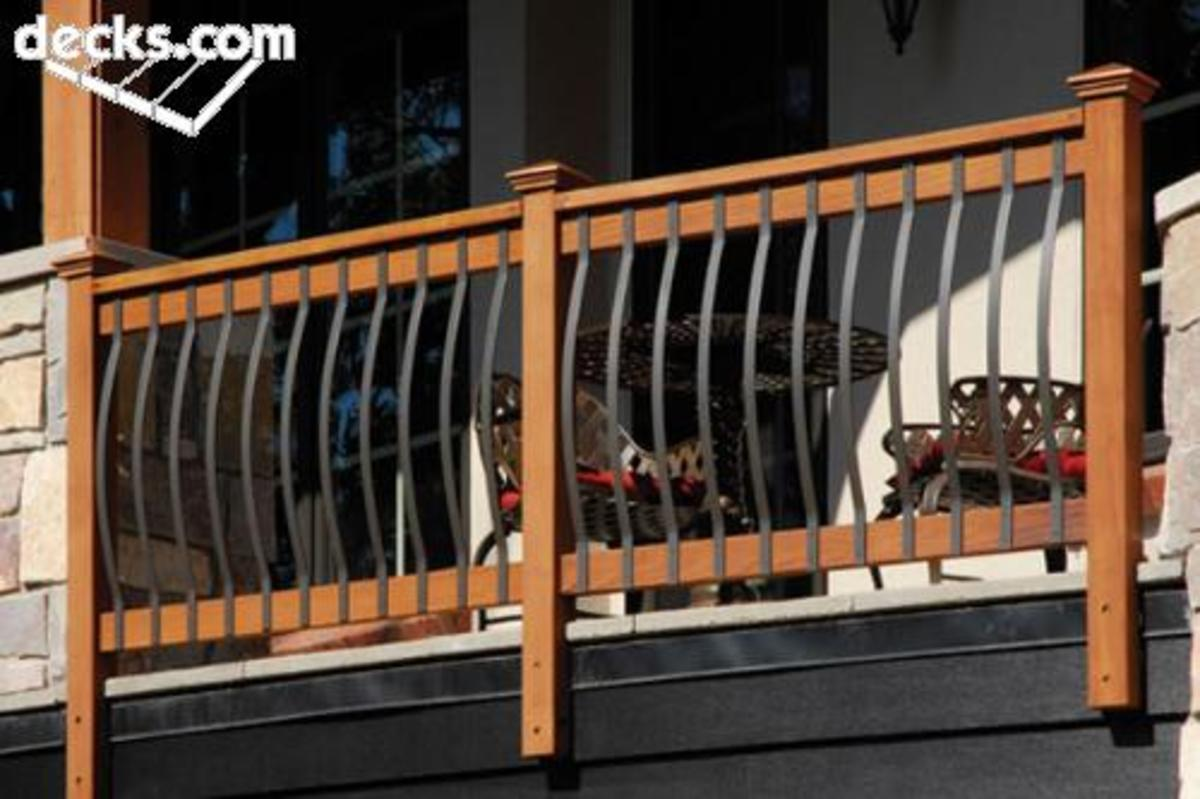 Railing #1 - a traditional wood and metal design with bowed out metal strips