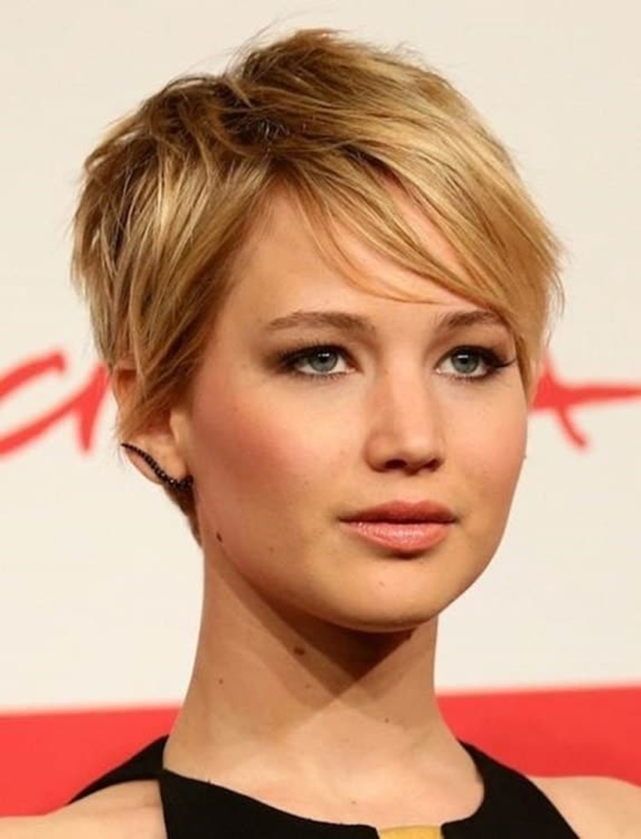 This longer pixie is great for round faces. Notice that the top is slightly higher to elongate the face. The layers and length of the hair add more depth.