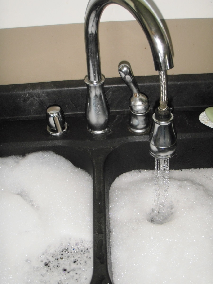 To prevent a clogged kitchen sink, on a monthly basis fill the sink or tub to the brim with hot water.