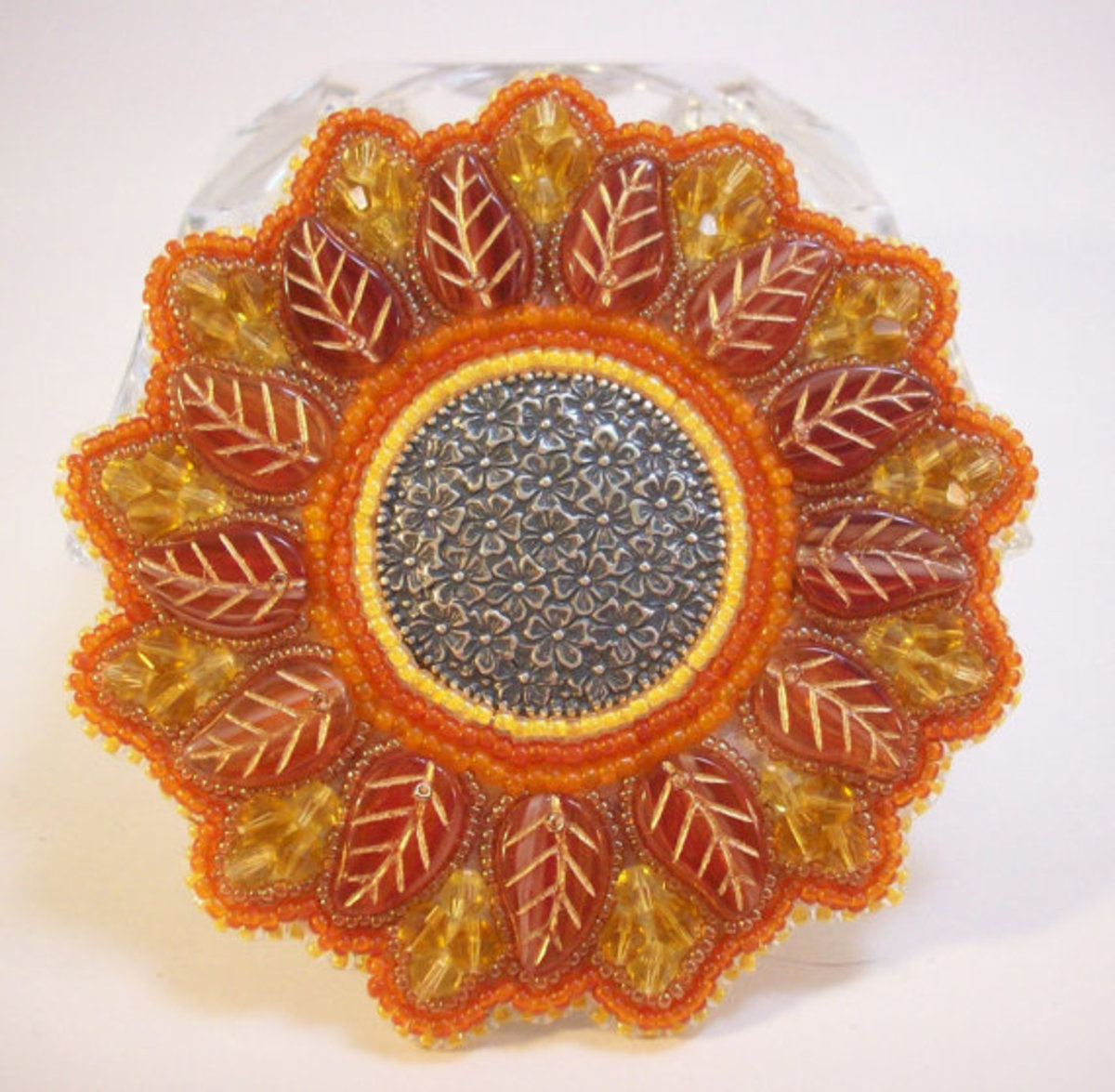 This is actually example of bead embroidery.  You can still create stunning pieces without using the bead holes.