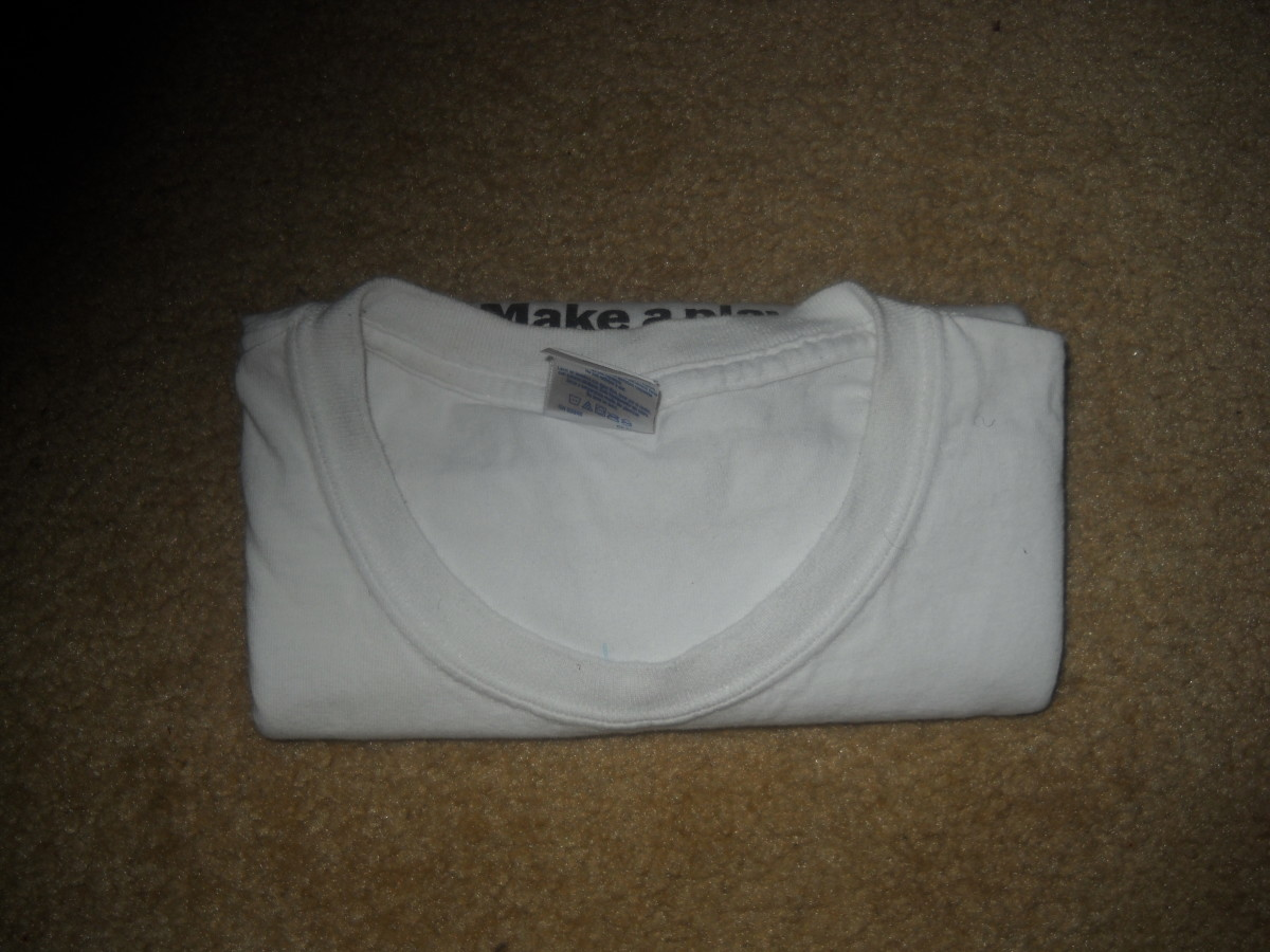 Front view - T shirt folded in thirds and ready for drawer.