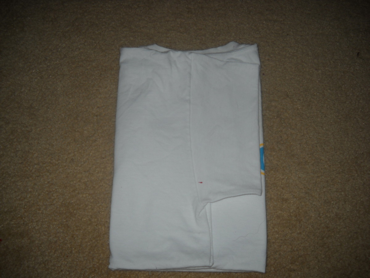 Back view - T shirt with other arm folded over, and arm sleeve folded under.