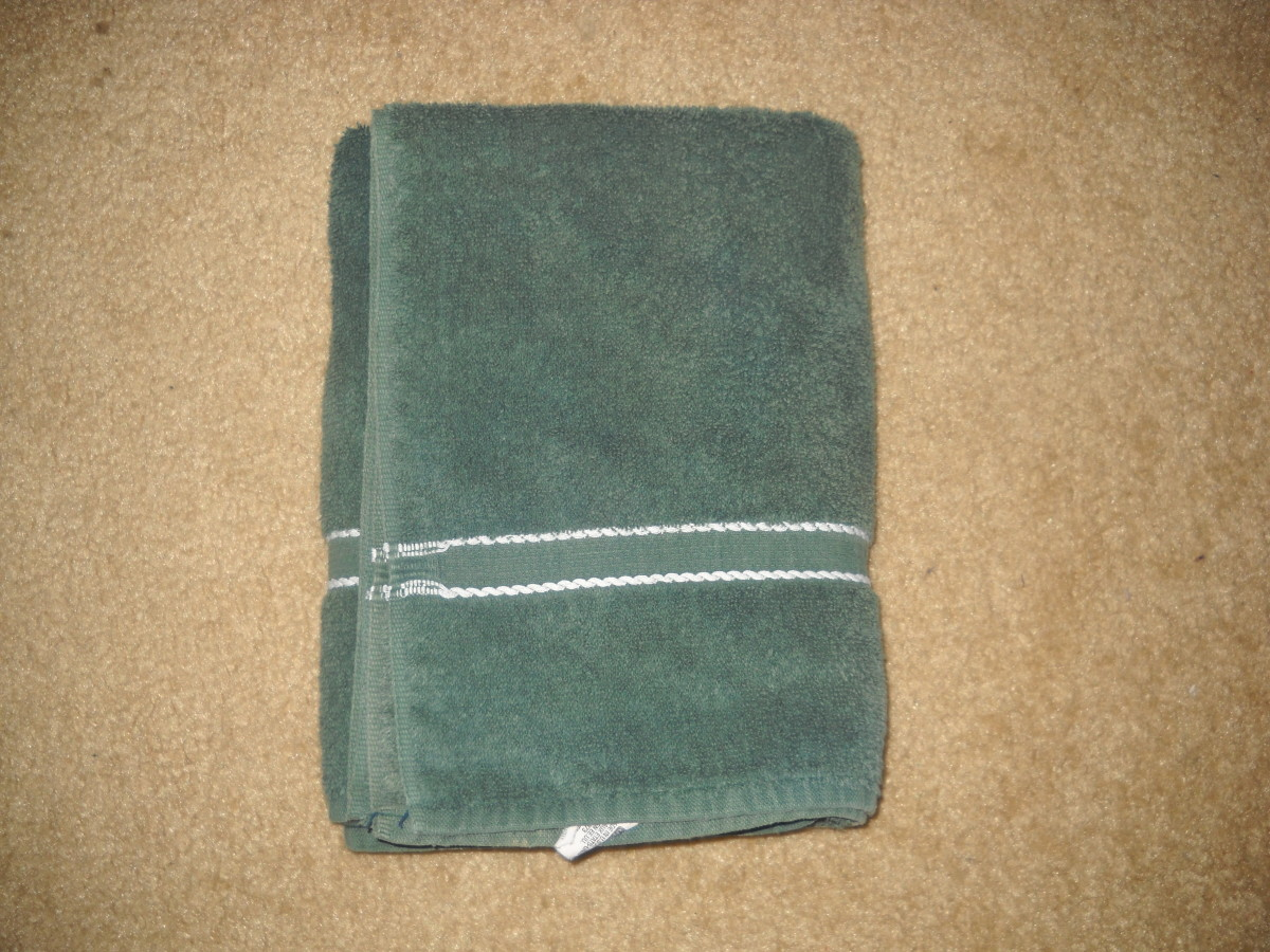 Towel folded on top of each layer in thirds, and finished