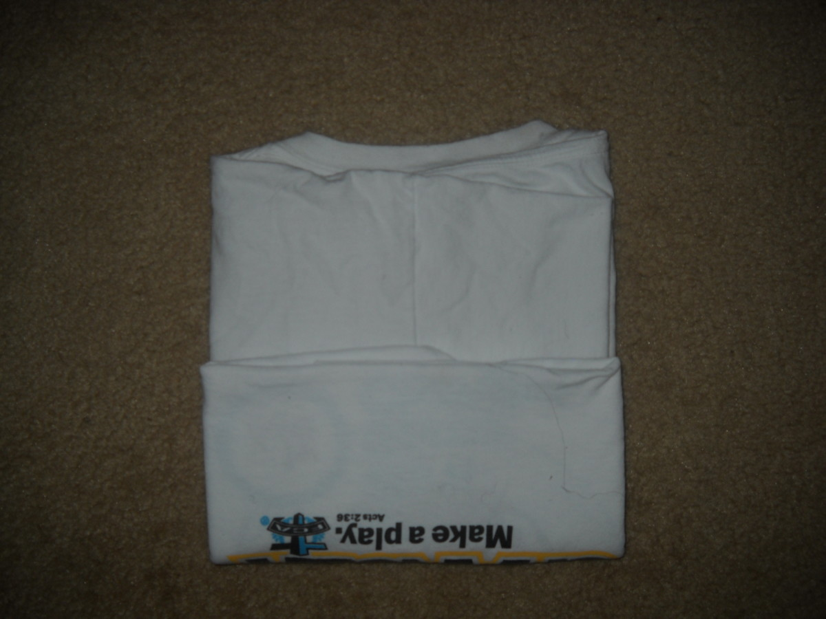 Back view - T shirt folded a third way up from the bottom.