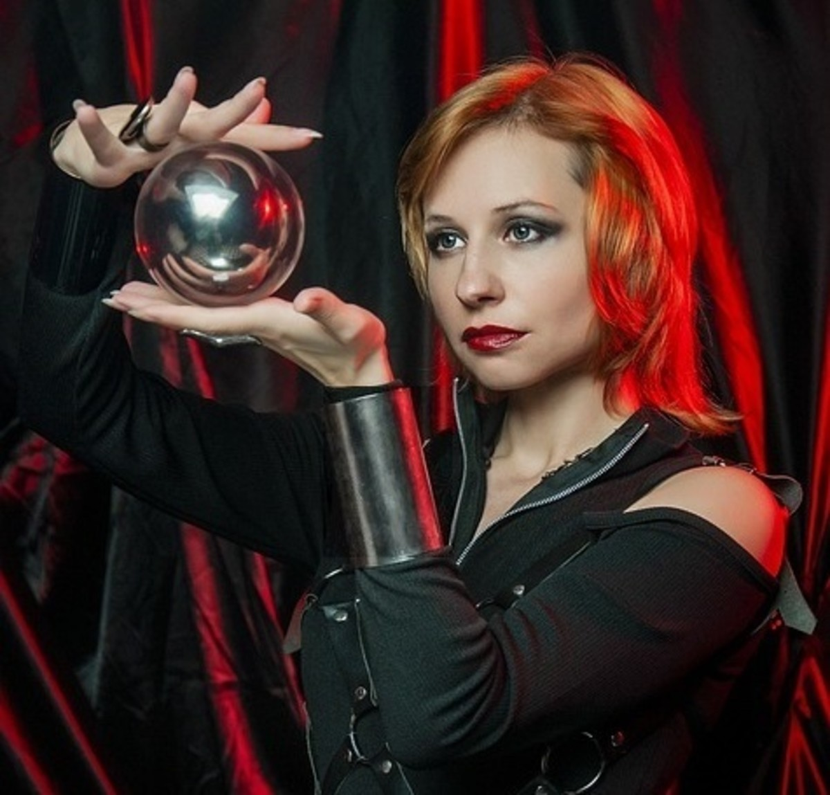 An individual holding a scryable object (for psychometry).