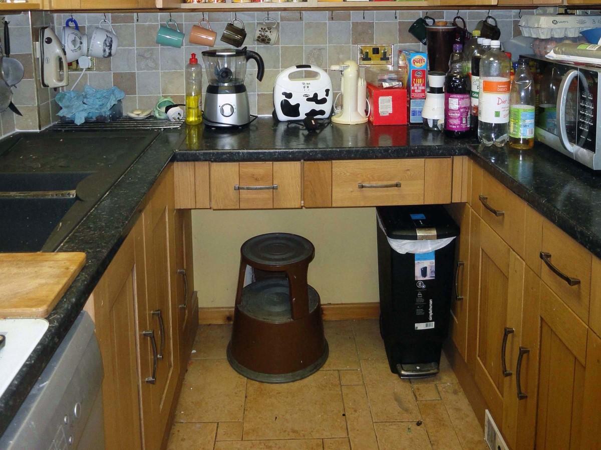 Kitchen worktop with open space below.