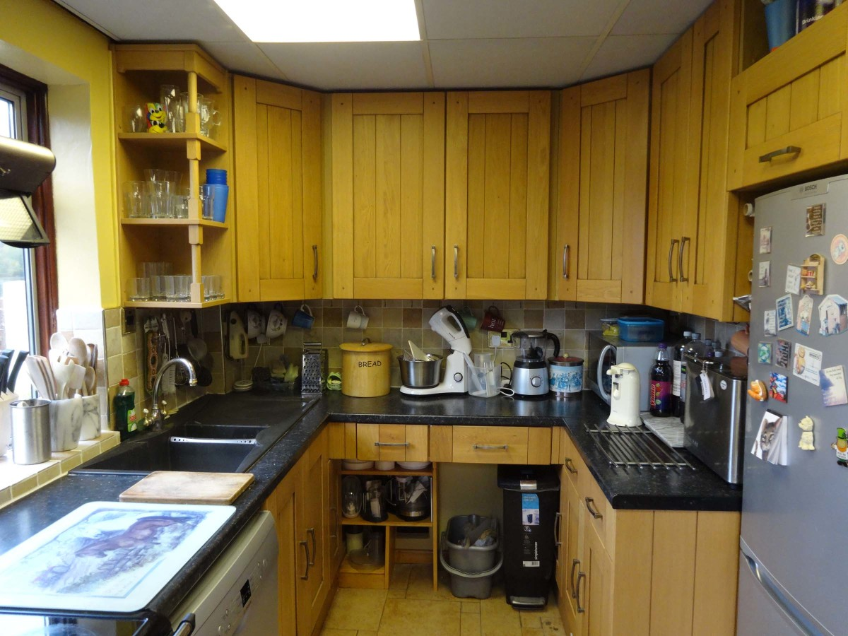 View of the whole kitchen with the new open shelving fitted.