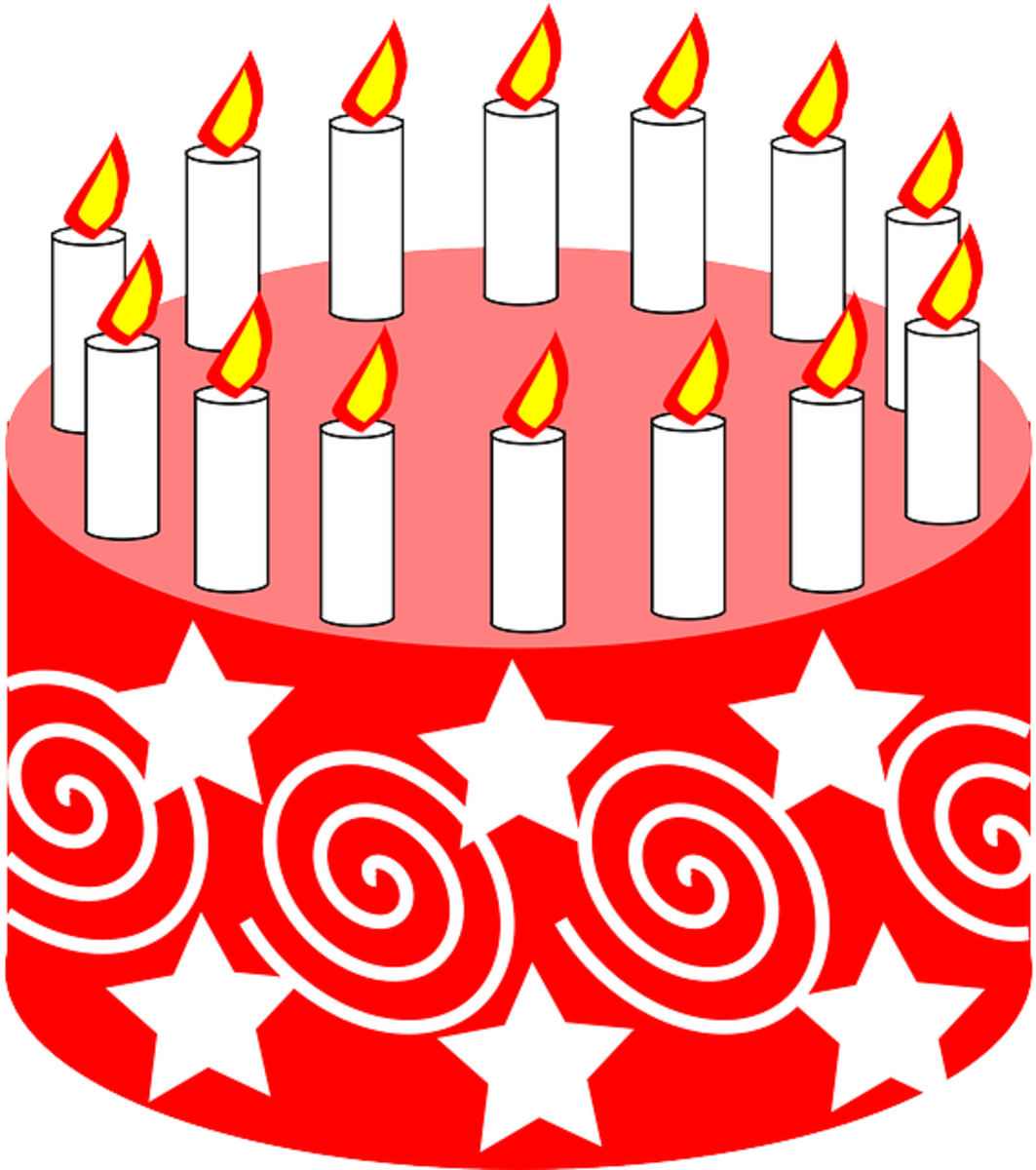 Red Birthday Cake with Swirls, Stars and White Candles