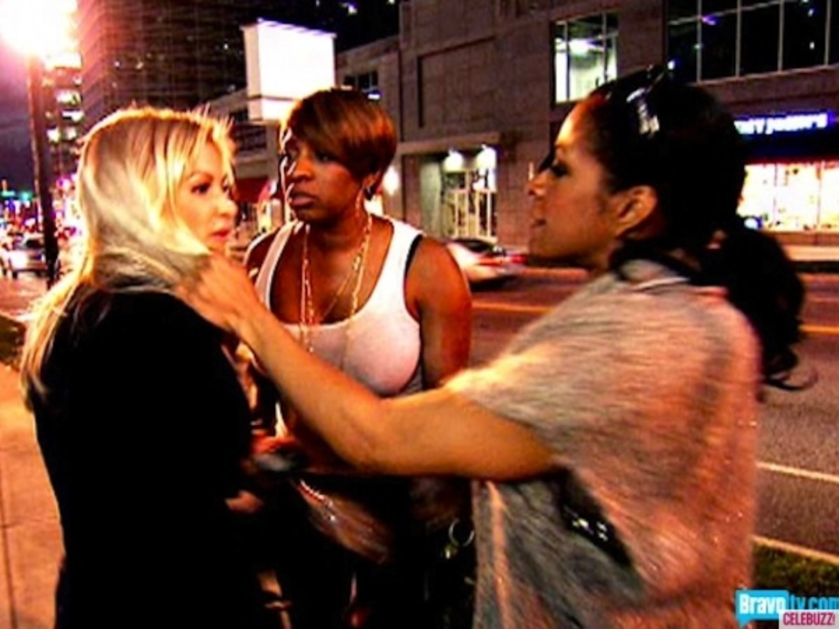 Sheree Pulling Kim's hair/wig.