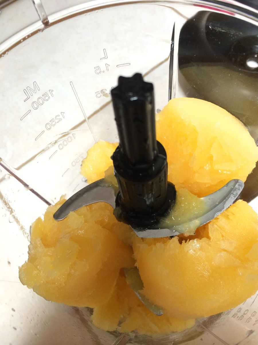 Before:  Frozen orange juice in the large blender container.