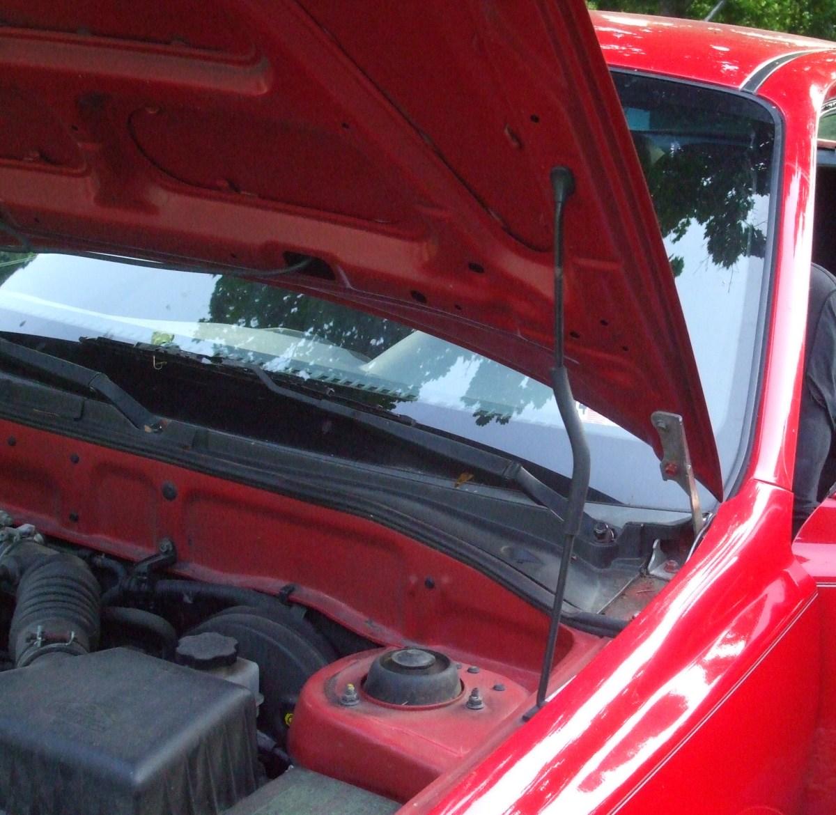 Rod holding up car hood.