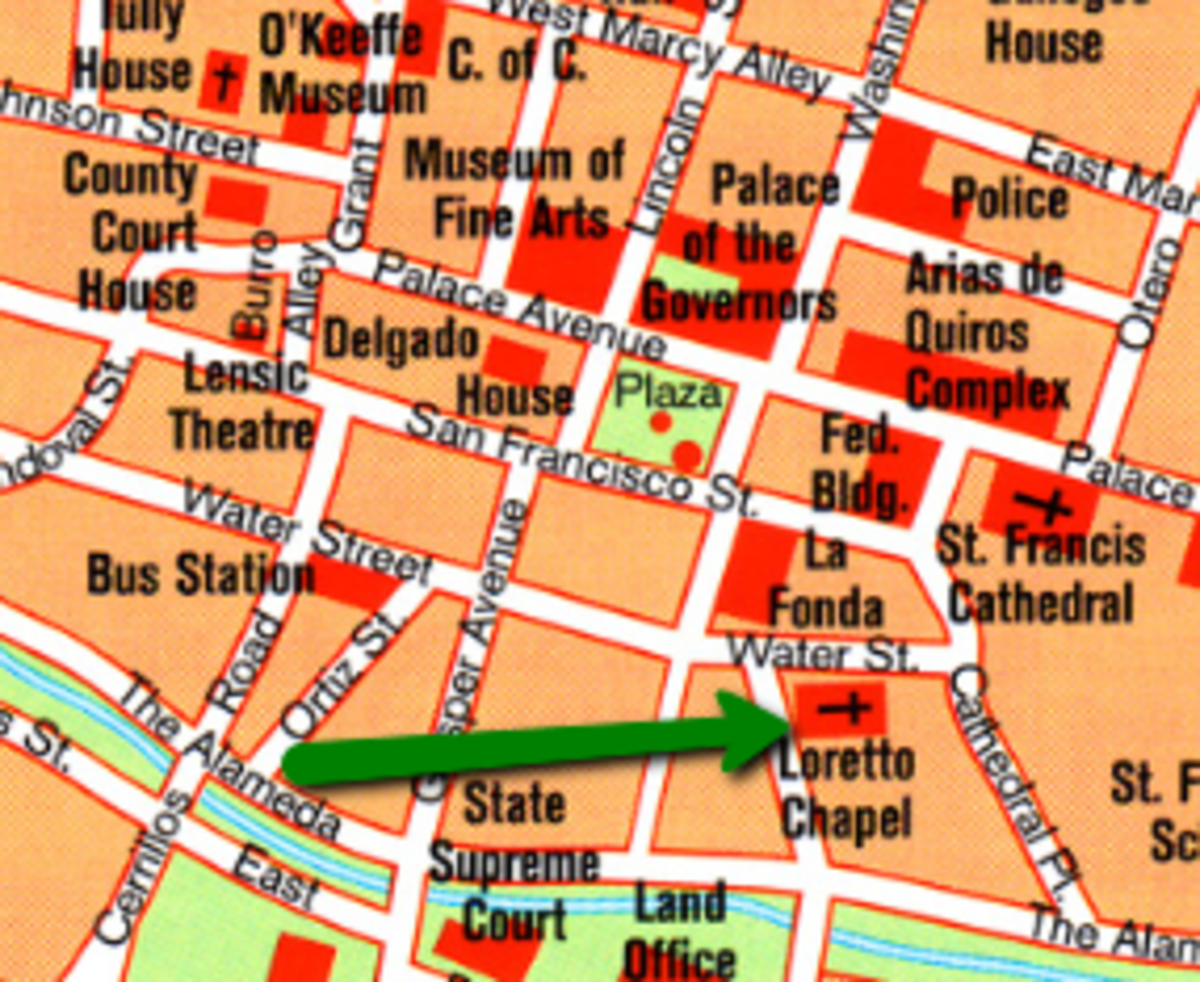 The green arrow shows the location of the Loretto Chapel, not far from The Plaza (the green square in the center), in downtown Santa Fe.