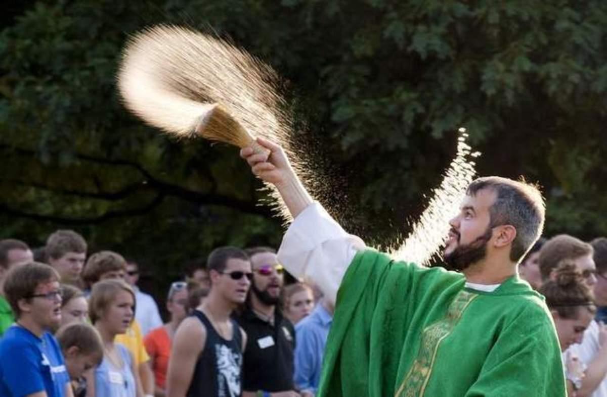 Asperging in the Catholic faith.