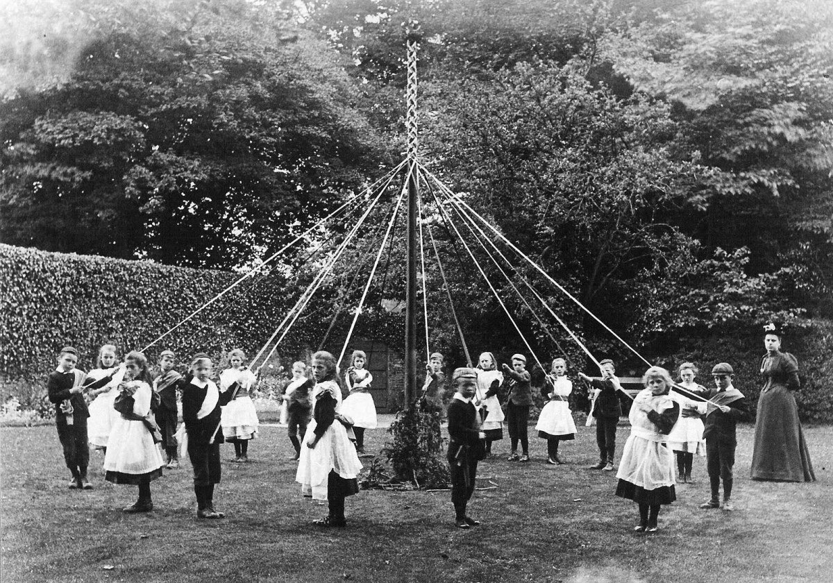 Dancing around the Maypole.