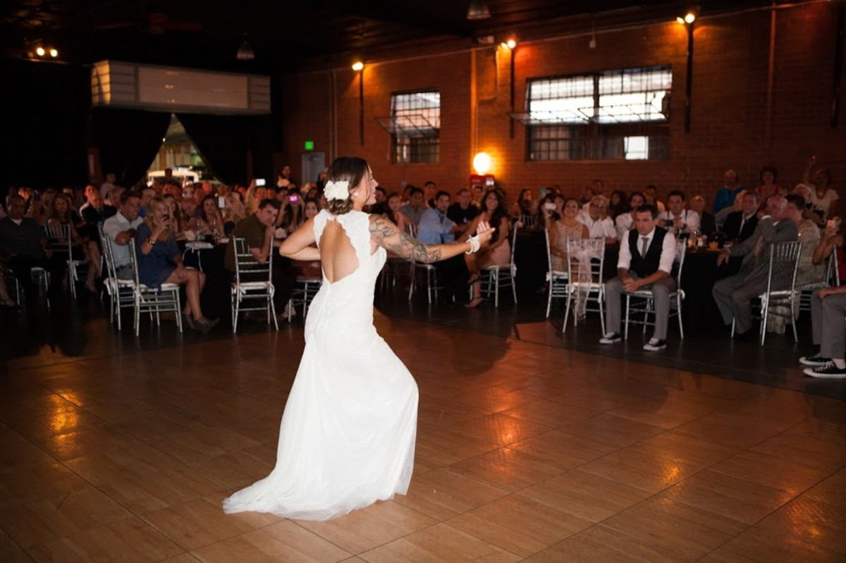 An overview of the venue with the silver chairs (& me dancing hula for my husband)!