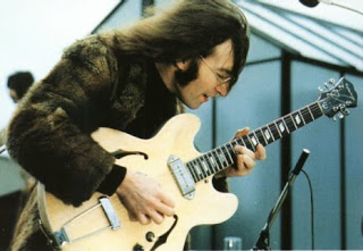 John Lennon with his Epiphone casino after he'd had the guitar modified.