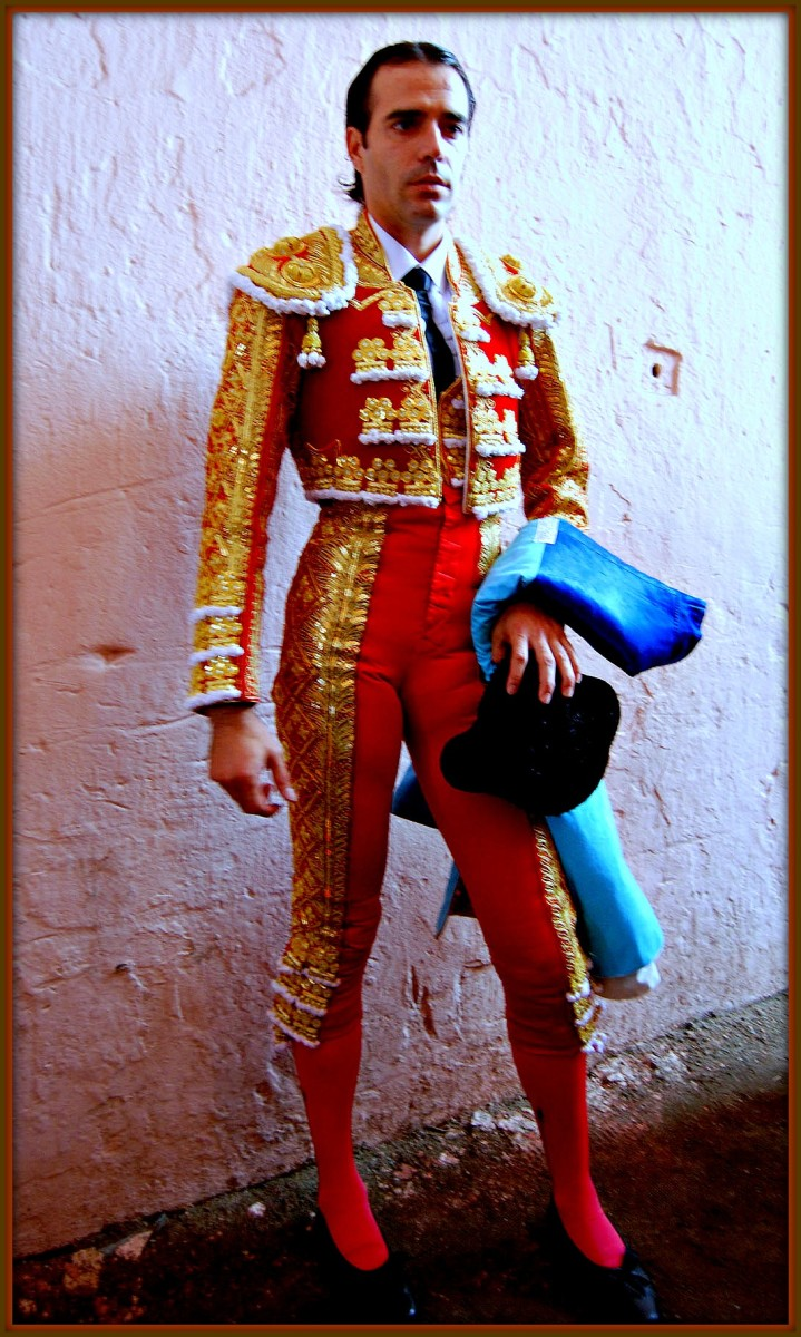 When the matador was awarded back in the golden age of bull fighting it usually involved a beautiful lady. When he had won he was to do a circuit of the arena to thank the many marry and happy spectators in the crowded seats.