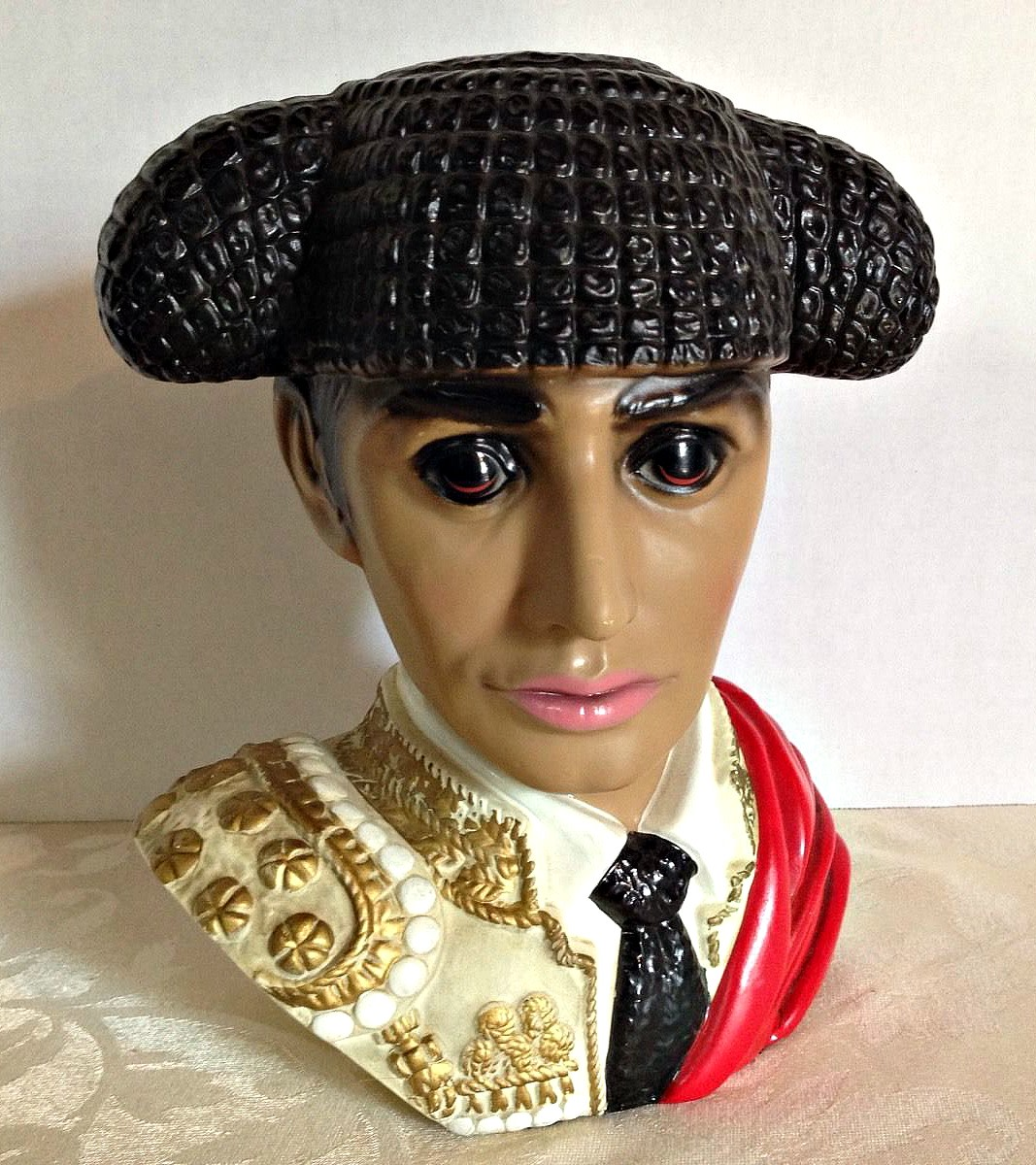 Vintage bust is of a Spanish Matador or what we call a Bull Fighter , and he is in great vibrant red, gold and black coloring with great life-like eyes.
