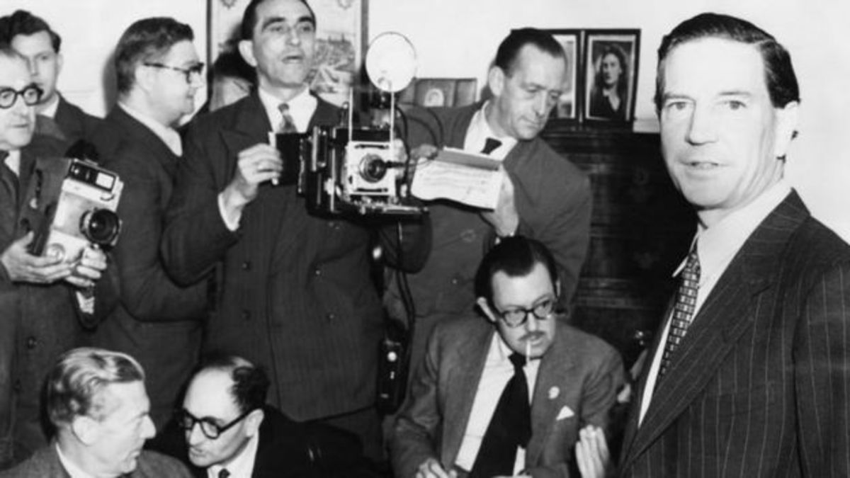 Philby's crowded press conference at his mother's Kensington flat - note BBC man Alan Whicker, seated right