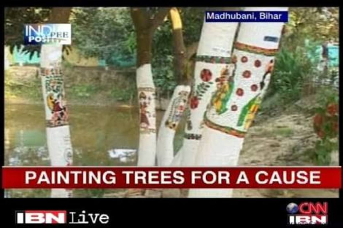 Madhubani paintings on trees to convey a message and also prevent deforestation.