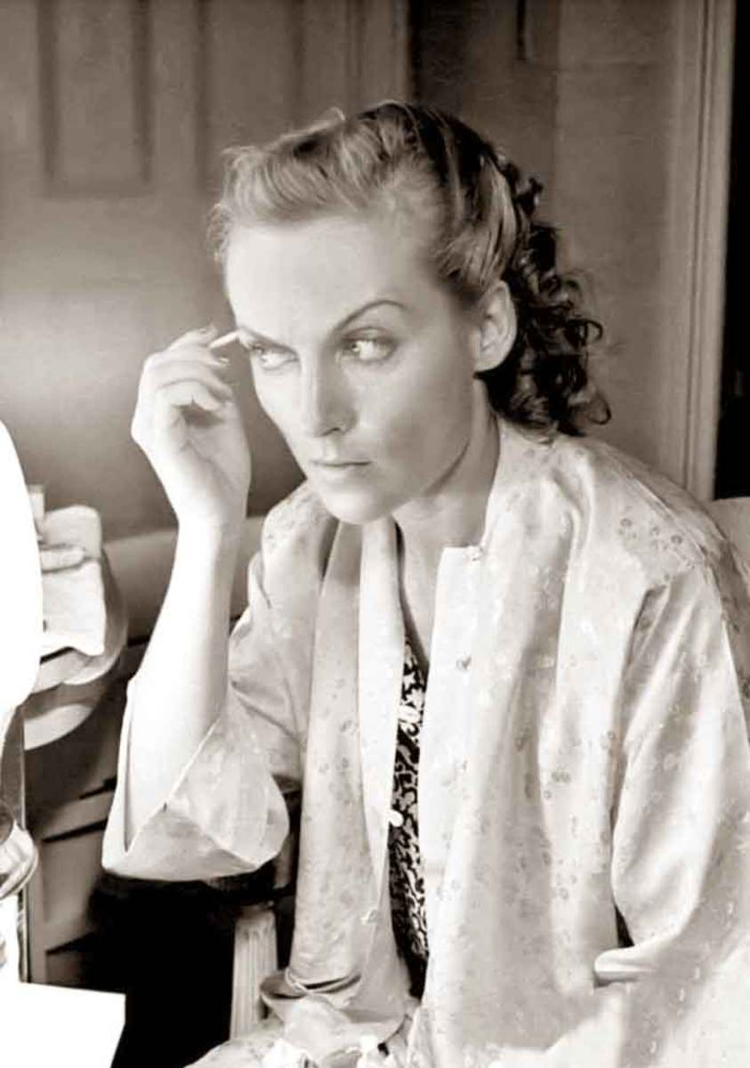 Carole Lombard applies her eyebrows with an eyebrow pencil