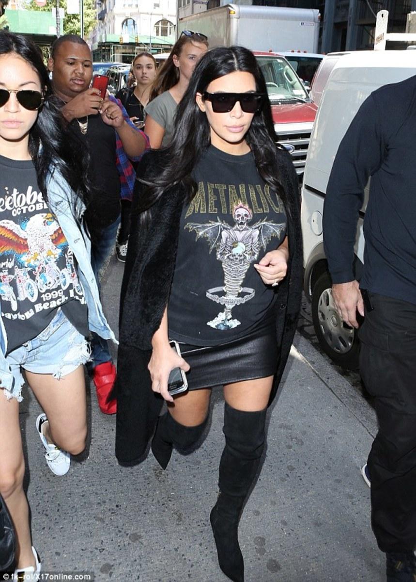 Kim Kardashian seen wearing a 90's-like Metallica shirt.