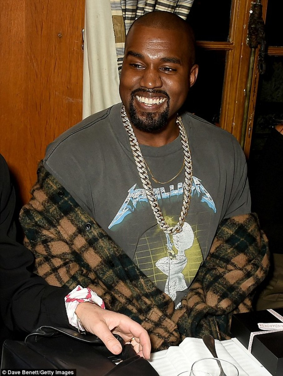 Kanye West, wearing the same shirt that I had prospected on buying during the high school days, but didn't want to get suspended!